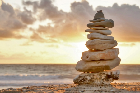 Balance - A composition of stacked stones on the beach