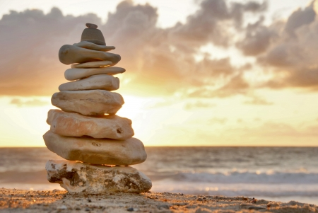 white stone: Balance - A composition of stacked stones on the beach
