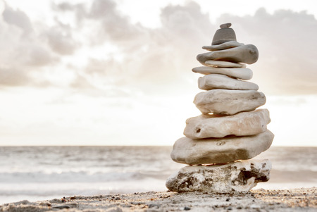 adamant: Balance - A composition of stacked stones on the beach