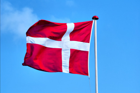 Danish flag - A danish flag is blowing in the wind  Stock Photo
