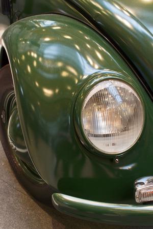 fender: Vintage Fender - An old green Police car. Stock Photo