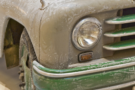 scrap trade: Old Jeep - The fender of an old disused green trucks. Stock Photo