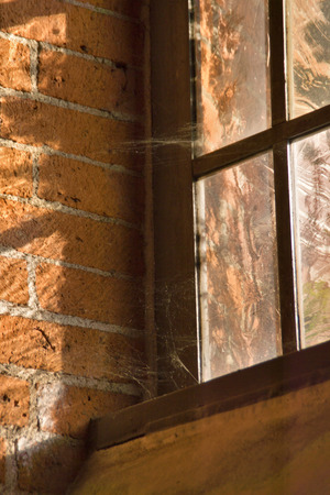 transom: Window - The sun is shining into a church window. Stock Photo