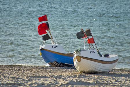 Fishing boats - Two fishing boats lying on the beach. photo