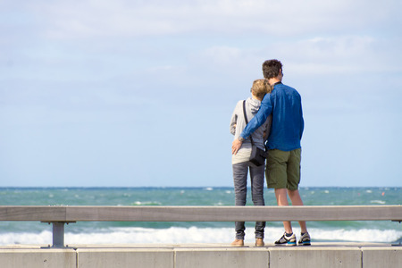 Two People are standing at the coast