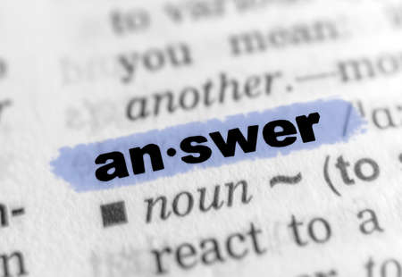 The word ANSWER in a dictionary - blue marker.