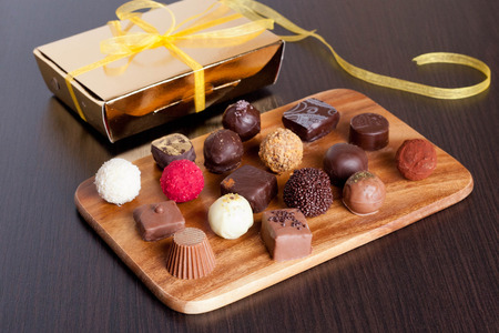 chocolaty: Chocolate handmade candies on a kitchen table. Chocolate box, close up, horizontal