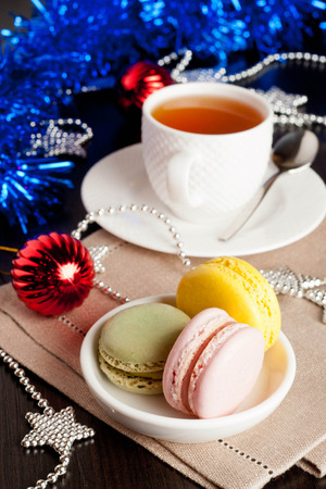 sweet treats: multicolor French macaroons sweet treats Christmas present, vertical