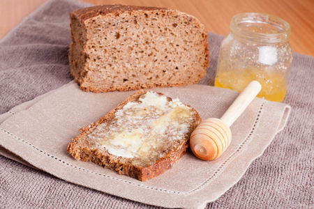 bread and butter: Fresh rye bread, butter and honey Stock Photo