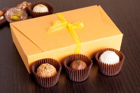chocolate cookie: Chocolate handmade candies on a black table. Chocolate box, close up