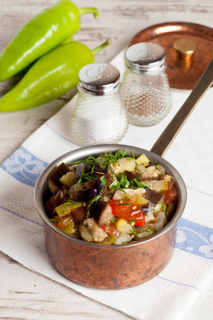stew pan: delicious vegetable stew in a pan, vertical top view, close-up
