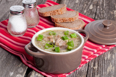 healthy meals: Mushroom cream soup in a bowl close-up horizontal