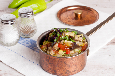 stew pan: delicious vegetable stew in a pan, horizontal top view, close-up