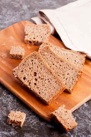 top veiw: Sliced rye bread on cutting board closeup, top veiw, vertical