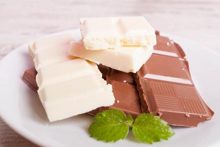 porous: Porous white chocolate and milk chocolate, closeup, horizontal