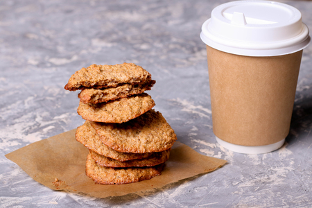 Paper cup of coffee and cookies, close up, horizontal