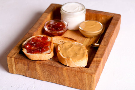Bread toast with jelly jam and peanut butter. Sandwich for breakfast