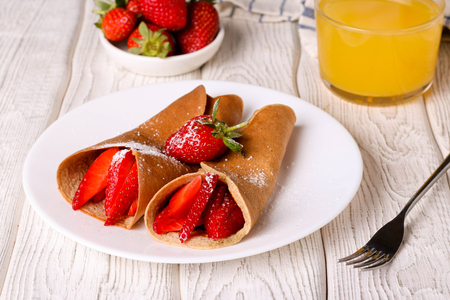 stuffing: crepes with berries and orange juice, horizontal
