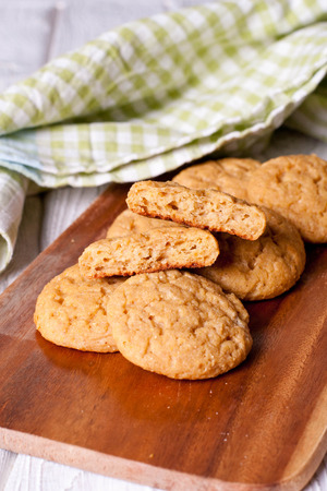 Oatmeal cookies on a wooden desk, close up, vertical Stock Photo
