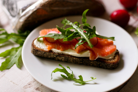 Canapes with smoked salmon, close up, horizontal Stock Photo