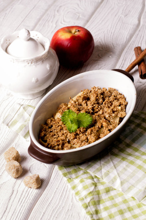 Oatmeal apple cowberry crumble cobbler in ceramic bowl, close up, top view, vertical Stock Photo