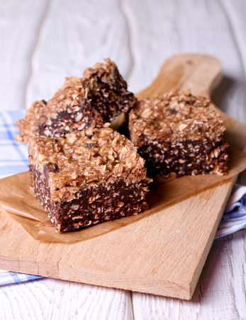 Chocolate energy bars with rolled oats, pecan nuts, dates, chia seeds and coconut flakes, close up Stok Fotoğraf