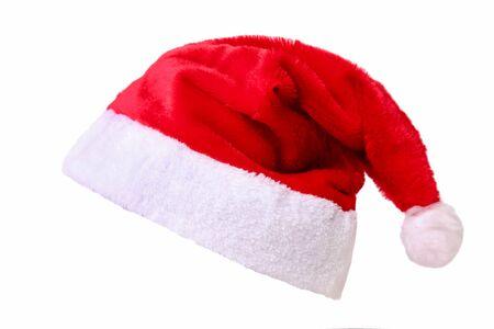 Bonnet de Noel rouge isolé sur fond blanc.