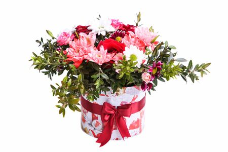 Bouquet of roses, dahlia and chrysanthemums in a gift box isolated on a white background.