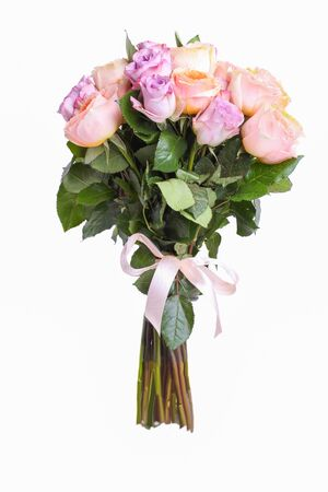 A bouquet of hybrid tea roses and floribunda isolated on a white background.
