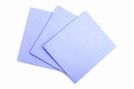 Blue viscose cloth for cleaning isolated on a blue background.