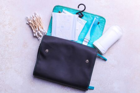 Travel kit for personal care products on a white background.