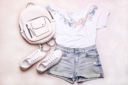 Collage of women fashion clothes with accessories on a white background. Фото со стока