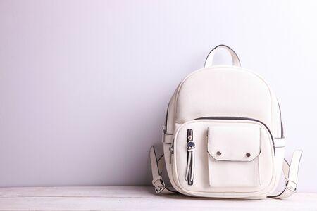 Stylish leather female backpack on a white background.