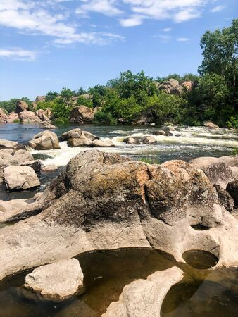 A winding river with rapids in a rocky gorge. Natural landscape.