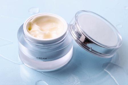 Face cream in a jar on a blue background. Skin care.