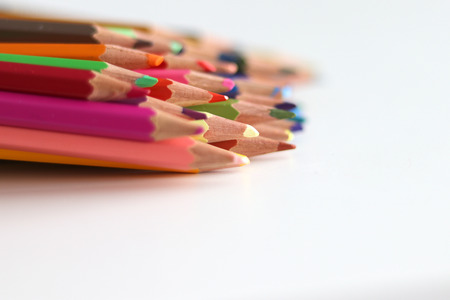 Bunch of colorful pencils lying on white background Stock Photo