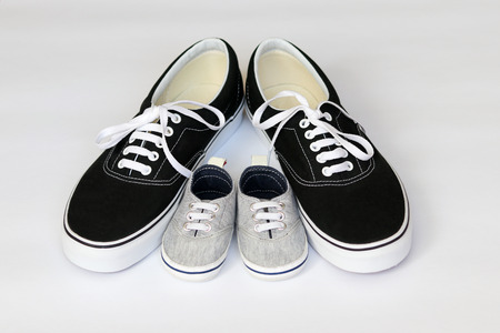 Father and son casual shoes on white background. Fathers day