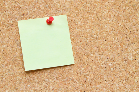 blank sticky note pinned to a cork board or bulletin board photo