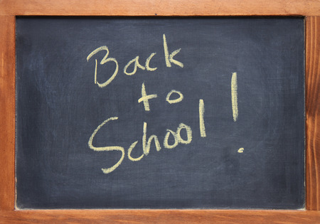 back to school written across a chalkboard  blackboard with an antique wooden frame photo