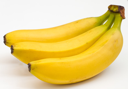 bunch up: close up of a bunch of healthy organic bananas on a white background Stock Photo