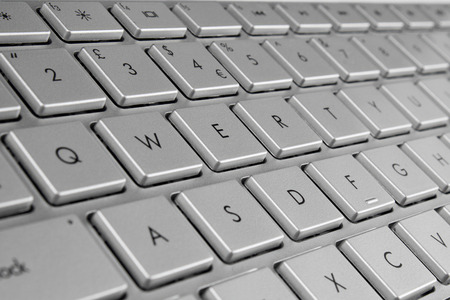 qwerty: close up of a grey qwerty keyboard
