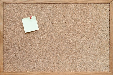 post it note pinned to a blank cork board  bulletin board with a wooden frame photo