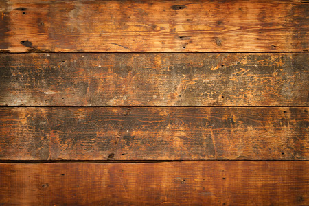 wood paneling: close up of  weathered and textured boards on an old wooden farm door Stock Photo
