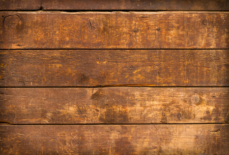 close up of  weathered and textured boards on an old wooden farm door Stockfoto