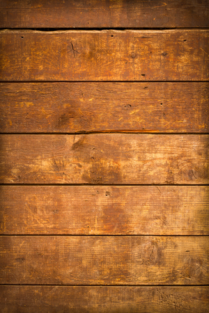 rough: close up of  weathered and textured boards on an old wooden farm door Stock Photo