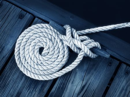 boat rope tied to dock securing boat
