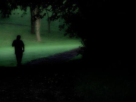 man walking into the light