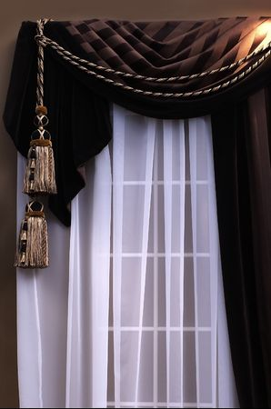 brown swag curtains with sheers on window