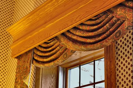 window treatment with swag curtain and cornice Stock Photo