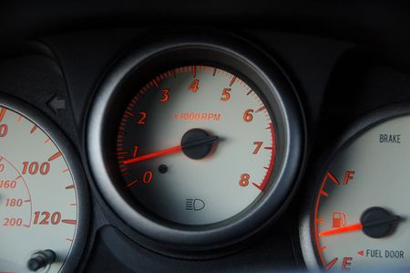 car interior dashboard speedometer and gas gage with red lights